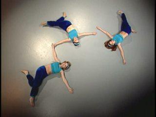 Bellydancers demonstrating static back stretch