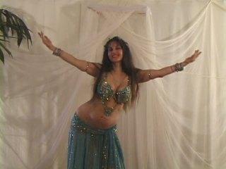 Jehan bellydancing in turquoise costume