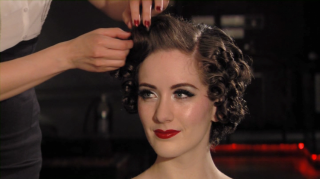 Burlesque dancer Medianoche with vintage hair