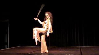 Galit Mersand bellydancing with stick, cane