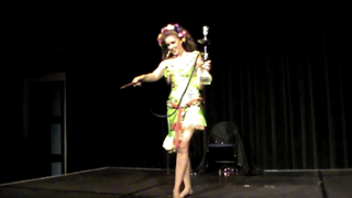 Galit Mersand performing shisha dance, bellydance, with melaya leff costume