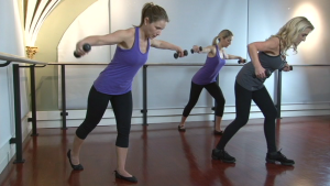Zayna Gold demonstrates arm exercises with weights