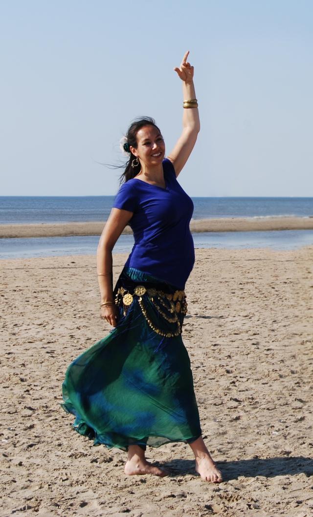 Kyria dancing pregnant on beach